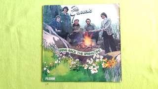 GENESIS . bring back the springtime . Vinyl record