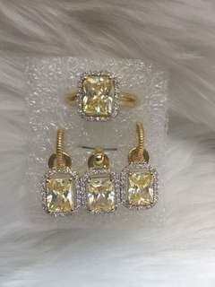 Set with pendant in yellow gold (with signity colored stone)