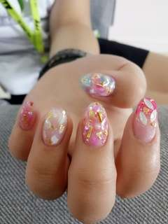 Gel nails with half tips extension with sea shell nail art with stud and gold foil