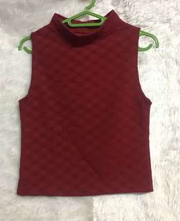 Semi closed neck red sleevess top