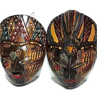 a set of two wooden mask, hand painted, wall mountable