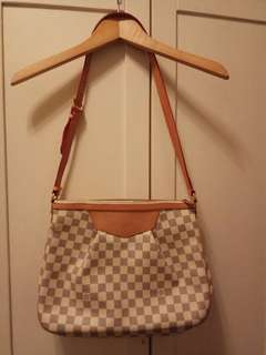 """LV bag 10""""x14"""" size...99% new..used twice only....no damage at all."""