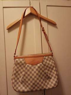 "LV Bag...10""x14"" size.....no damage at all...99% new...used twice only"