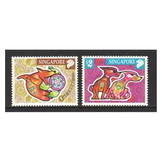 SINGAPORE 2006 ZODIAC YEAR OF DOG COMP. SET OF 2 STAMPS IN MINT MNH UNUSED CONDITION