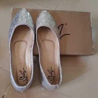 Sepatu flat (zoes)