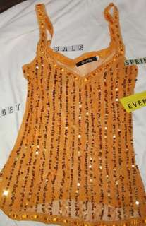 Sequined orange see through top for the beach