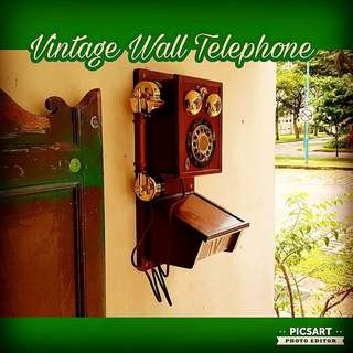 Vintage Wooden Wall Telephone in the shape of Antique telephone. Button type. Selling as non-working display unit. Size as in the photos. Beautiful Condition. $55 Clearance offer, sms 96337309.