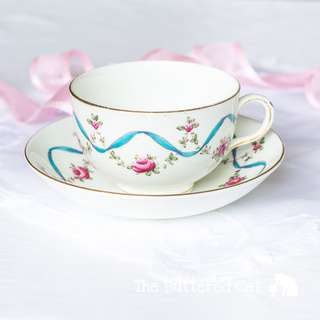 Beautiful antique blue ribbons and roses English china cup and saucer, for the collector