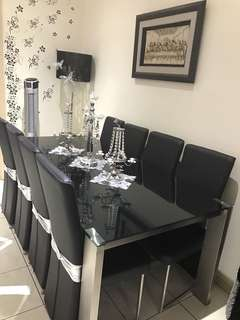 9 pec of dining set like new in black color lather use 2/3 Tims from Harvey Norman . To big for us original price $2700.