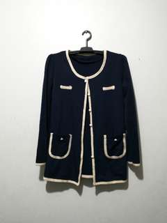 Navy coat with cream trimmings