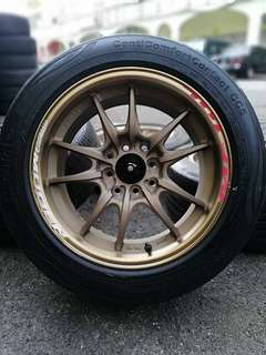 Mugen mf10 15 inch sports rim jazz tyre 70%. *new rim + 2nd tyre*
