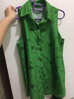 Green sleeveless buttondown top