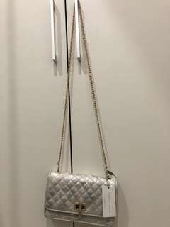 Charles and keith silver sling bag