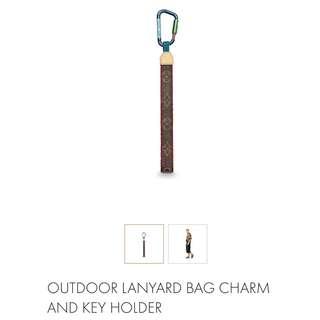 Louis Vuitton outdoor landyard and bag charm