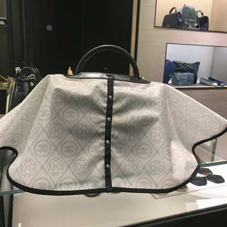 Chanel handbag raincoat