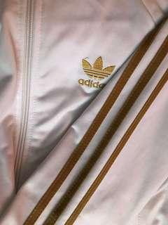 Gold and white adidas track jacket