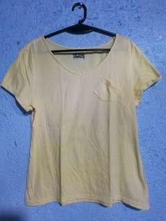 Yellow V-neck shirt