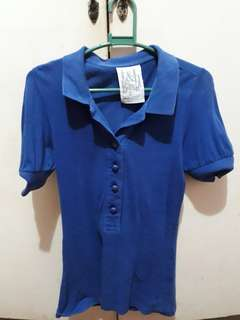 Folded and Hung Preloved Polo Shirt