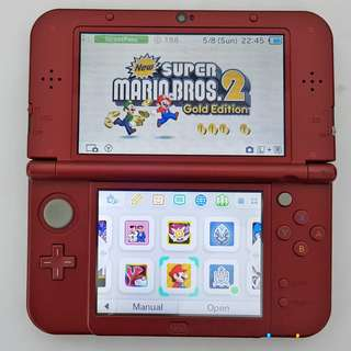 New 3DS XL Red with box & 32GB Memory Card. Allows you to play homebrew games