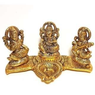 Golden Statue of Deity Laxmi, Lord Ganesha and Deity Sarswati