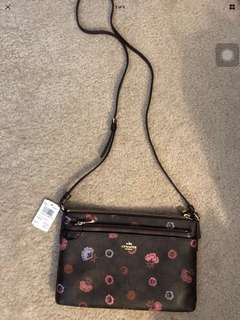 Coach primrose Floral printed cross body pop-up pouch in brown multi f24373