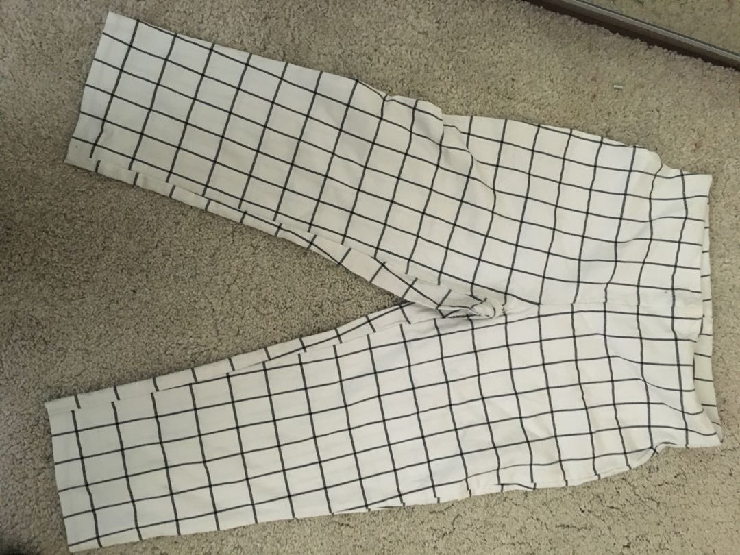 White and black checkered trousers
