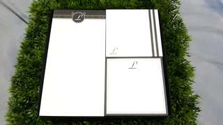 "Notepads with ""L"" print"