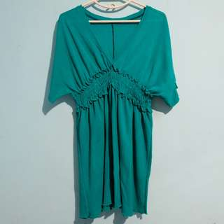 Dark turquoise dress with ruffle detail