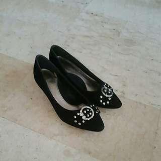 Close black suede shoes