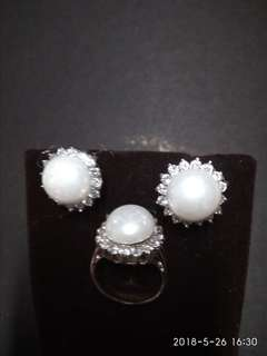 Set of pearl studed with diamonds ring and earings in silver settings