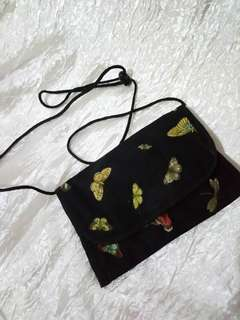 Printed butterfly sling bag