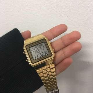 world time gold casio watch