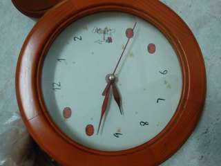 Battery operated small brown wall clock