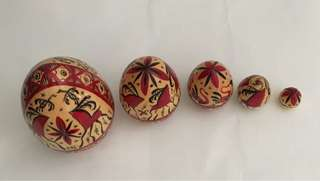 Nesting Eggs. Wooden. Lacquered. Painted in Siberian Mezenskaya pattern.