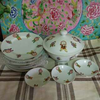 Vintage bowls and plates with kid's motif.