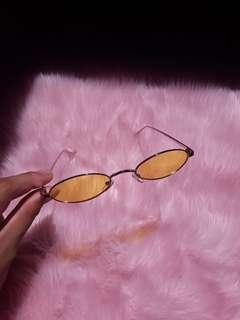 Trendy yellow lensed skinny sunnies