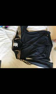 Black and gold adidas track suit jacket