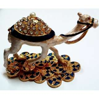 Beautiful crystal studded metal  camel on golden coins