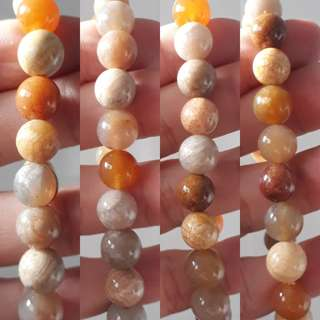Exquisite Coral fossil (珊瑚玉) bracelet. Bead size 10mm x 20 beads. Excellent craftsmanship.