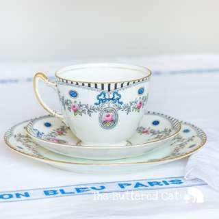 Elegant antique English tea trio, blue ribbon bows, rose cameos, swags and garlands, Trio B