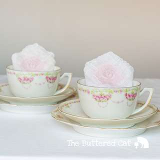 Two shabby chic antique English china cups and saucers, pink rose garlands