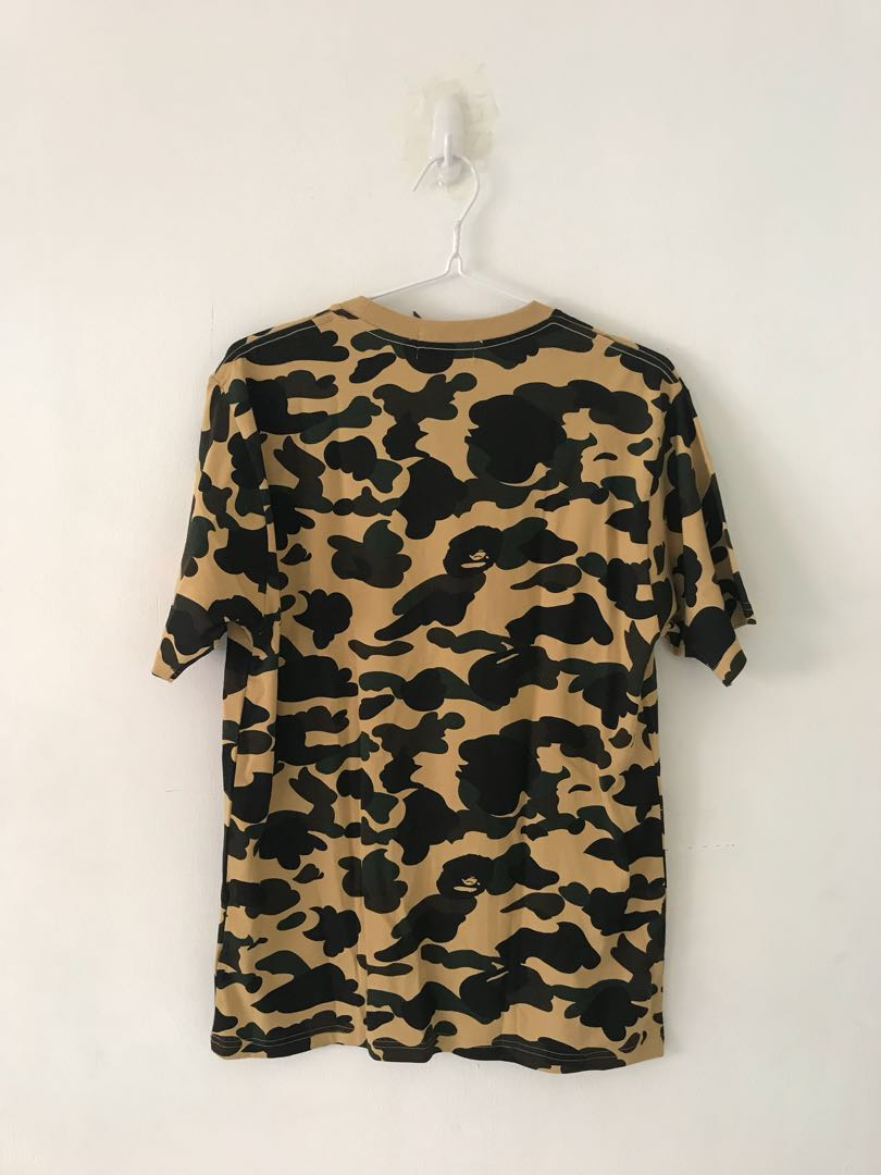 88a7b1d7 Bape first Camo (yellow) tee, Men's Fashion, Clothes, Tops on Carousell