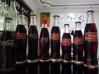 Coca-Cola  ( set of 8 bottles)