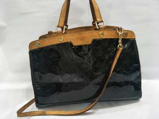 LV sling bag with leather handle