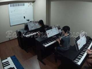 Children piano lesson