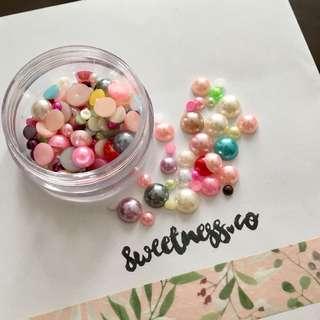 Assorted flatback pearls