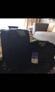 Samsonite luggage and matching bag