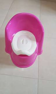 New baby toddler seated  Potty