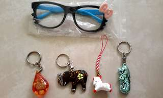 different keychains and a pair of hello kitty ' glasses '