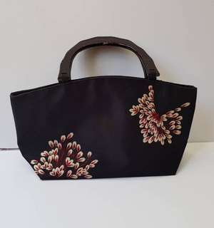 Hand Embroidered bag with carabao horn handle